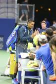 Professional tennis player Nick Kyrgios from Australia signing autographs after win at US Open 2014 match — Stock Photo