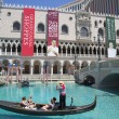 Unidentified tourists enjoy gondola ride at Grand Canal at The Venetian Resort Hotel Casino — Stock Photo #63781175