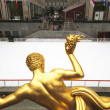 Statue of Prometheus and ice-skating rink at the Lower Plaza of Rockefeller Center — Stock Photo #66861817