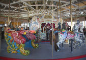 Horses on a traditional fairground B&B carousel at historic Coney Island Boardwalk in Brooklyn — Photo