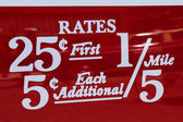 New York City taxi rates decal. This rate was in effect from July 1952 till December 1964 — Stock Photo
