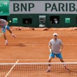 Grand Slam champions Mike and Bob Bryan of United States in action during second round match at Roland Garros 2015 — Stock Photo #76427097