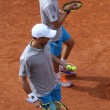 Grand Slam champions Mike and Bob Bryan of United States in action during second round match at Roland Garros 2015 — Stock Photo #76427233