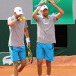 Grand Slam champions Mike and Bob Bryan of United States in action during second round match at Roland Garros 2015 — Stock Photo #76427079