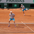 Grand Slam champions Mike and Bob Bryan of United States in action during second round match at Roland Garros 2015 — Stock Photo #76427117
