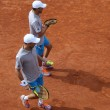 Grand Slam champions Mike and Bob Bryan of United States in action during second round match at Roland Garros 2015 — Stock Photo #76427251