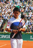 Professional tennis player Kei Nishikori of Japan during second round match at Roland Garros 2015 — Stock Photo