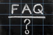 Abbreviation FAQ handwritten on black chalkboard — Stock Photo