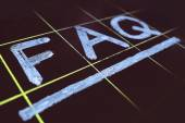 Abbreviation FAQ handwritten on black chalkboard — Stock Photo