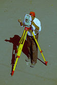 A surveyor at work with an infrared reflector used for distance  — Stock Photo
