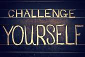 Challenge yourself phrase handwritten on black chalkboard — Stock Photo