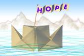 Origami paper boat with flag writing HOPE — Stock Photo