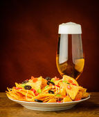 Tortilla chips and beer — Stock Photo