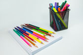 Colored pencils and markers on a white background — Stock Photo