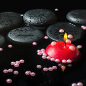 Spa still life of zen stones with drops, pearl beads and  red ca — Stock Photo