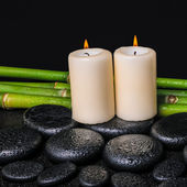 Spa concept of zen basalt stones, candles and natural bamboo wit — Stock Photo