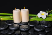 Spa concept of zen basalt stones, white flower plumeria, candles — Stock Photo