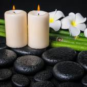 Spa concept of zen basalt stones, two white flower frangipani, c — Stock Photo