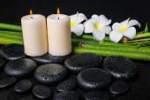 Spa concept of zen basalt stones, three white flower frangipani, — Stock Photo