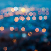 City blurring lights abstract circular bokeh on blue background, — Stock Photo