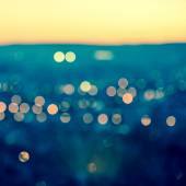 City blurring lights abstract circular bokeh on toned blue backg — Stock Photo