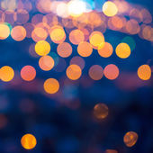 Merry christmas lights abstract circular bokeh on blue backgroun — Stock Photo