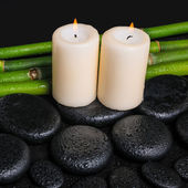 Spa concept of zen basalt stones,  candles and natural bamboo wi — Stock Photo