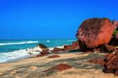 Beautiful tropical coast with big stones and black sand of the I — Photo