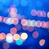 Beautiful city blurring lights abstract circular bokeh blue back — Stock Photo