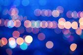 Beautiful big city blurring lights abstract circular bokeh blue  — Stock Photo
