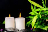 Spa setting of zen basalt stones with drops, white candles, bead — Stock Photo