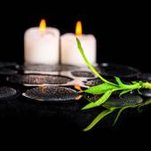 Beautiful spa still life of green twig bamboo and candles on zen — Stock Photo
