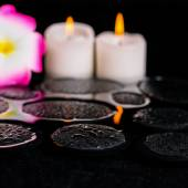 Beautiful spa background of zen basalt stones with drops, candle — Stock Photo