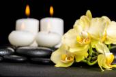 Beautiful spa background of yellow orchid phalaenopsis and candl — Stock Photo
