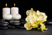 Beautiful spa concept of yellow orchid phalaenopsis and candles  — Stock Photo
