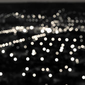 Abstract white black circular bokeh background, city lights in t — Stock Photo