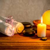 Spa still life of white towels, candle, thai herbal compress bal — Stock Photo