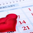Page calendar with two red hearts on the date of February 14 Valentine's Day — Stock Photo #62362481