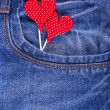 Two red hearts closeup in jeans pocket on Valentine's Day — Stock Photo #62362797