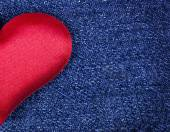 Background for Valentine's Day from the texture jeans and red hearts — Stock Photo