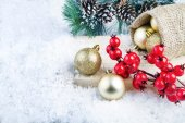 Christmas golden balls pinecone and rosehip . — Stock Photo