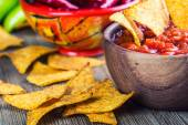 Salsa with tortilla chips and chilli peppers.Macro concept — Stock Photo