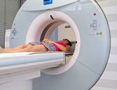 Woman as a patient being investigated for magnetic resonance scanner. — ストック写真