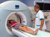 Woman as a patient being investigated for magnetic resonance scanner. — Stock fotografie