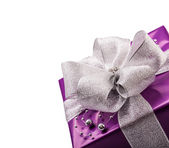 Christmas or Valentine's purple gift with silver ribbon abstract  background — Zdjęcie stockowe