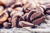Coffee beans on grunge wooden background. — Stock Photo