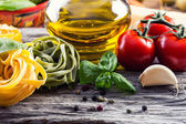 Italian and Mediterranean food ingredients on old wooden background. — Stock Photo
