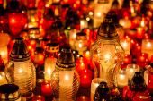 Many burning candles in the cemetery at night on the occasion memory of the deceased.Souls. — Stock Photo