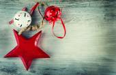 Jingle bells and wooden red star as christmas decorations on an old wooden table — Stock Photo