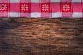 Top view of checkered napkin on wooden table — Stock Photo